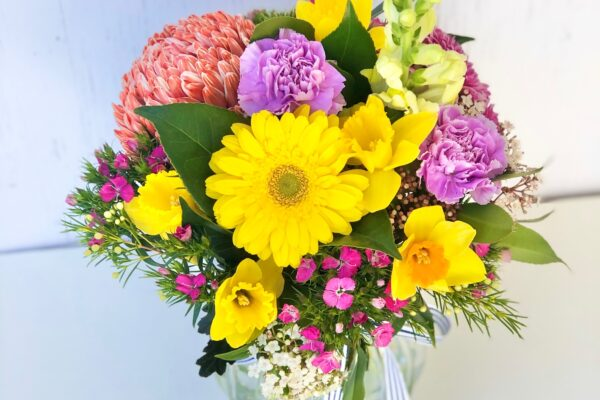 Mixed colour flowers in a vase